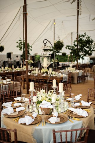 tented-wedding-reception-table-with-light-blue-tablecloth-taupe-fabric-hanging-lantern-candles
