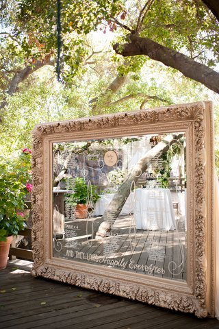 large-framed-mirror-displays-the-table-assignments
