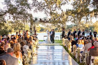 bride-and-groom-at-lake-wedding-ceremony-under-tree