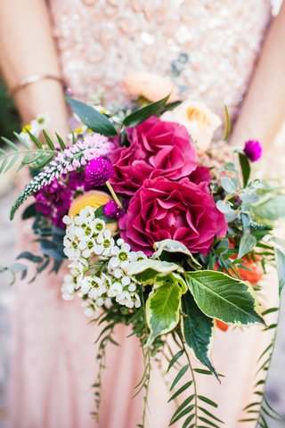 red-white-yellow-fuchsia-flowers-with-greenery-in-a-bridesmaid-bouquet-with-a-rustic-feel