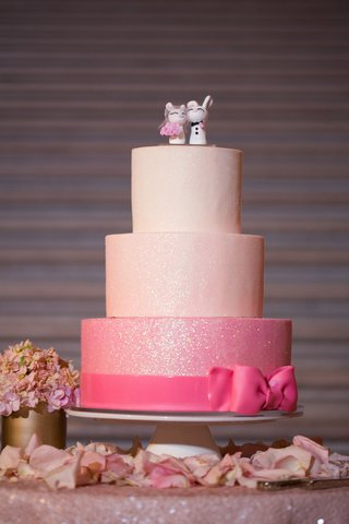 wedding-cake-with-two-pink-layers-white-layer-glittery-sheen-hot-pink-bow-custom-bunny-toppers
