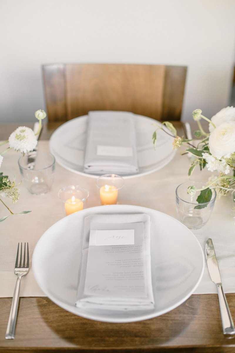 White Place Settings on Neutral Table