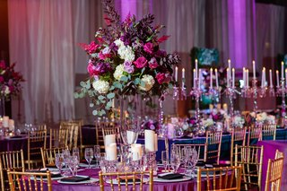 wedding reception andrew mellon auditorium gold chair purple teal linen candelabra purple magenta flowers