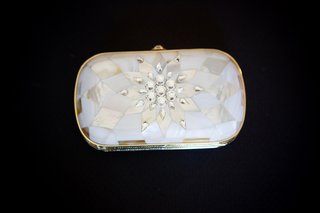 white-clutch-with-geometric-rose-gold-pattern-and-rhinestones