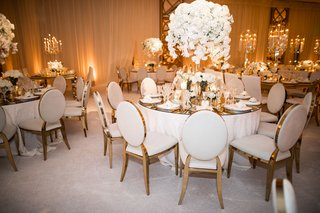wedding reception white gold ballroom design gold chairs white cushions revelry event designers
