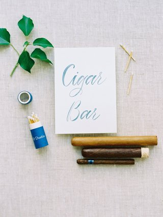 wedding-reception-outdoor-cigar-bar-at-reception-with-matches-personalized-and-cigar-options