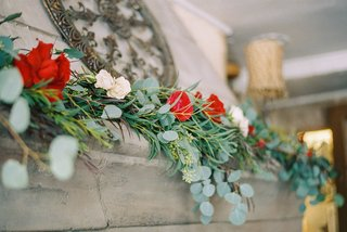 beauty-beast-movie-styled-wedding-shoot-red-white-greenery-floral-runner-matel-cottage-cozy-venue