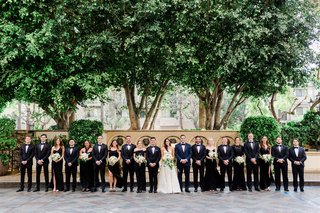 wedding party groomsmen in tuxes suits and bridesmaids in black dresses los angeles
