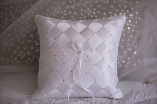 satin-checkered-ring-bearer-pillow-with-rhinestone-pearl-details-and-thin-ribbon-for-rings