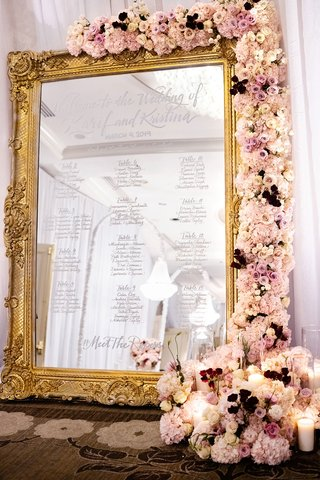 wedding reception four seasons hotel los angeles at beverly hills gold mirror frame pink purple flowers seating chart calligraphy