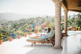 bridesmaids-lounging-on-terrace-with-pool-destination-wedding-overlooking-mexico-tropical-ideas