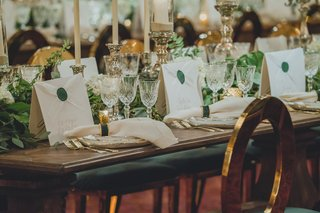 wedding-reception-hotel-gold-oval-back-chairs-wood-table-gold-flatware-antique-cut-crystal-wax-seal