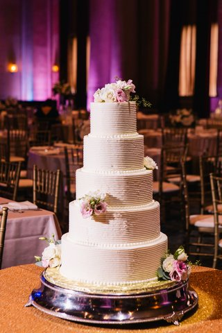 five-tier-wedding-cake-with-buttercream-frosting-and-fresh-flowers