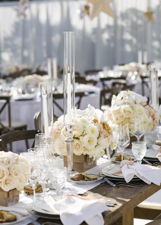 wooden-tables-topped-with-short-floral-arrangements