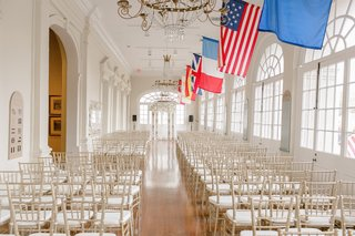 wedding-ceremony-with-gold-chiavari-chairs-at-gallery-of-the-cabildo-museum-new-orleans