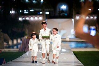 sundown-wedding-ceremony-for-jewish-wedding-three-ring-bearers-in-short-suits-with-yarmulkes
