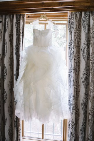 vera-wang-wedding-dress-hanging-on-window