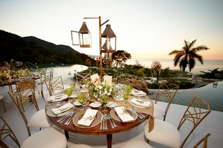 wood-reception-table-next-to-hotel-pool-and-ocean-view