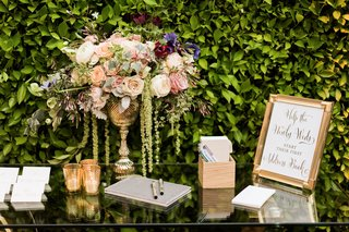 escort-card-table-with-guest-book-address-book-sign-gold-vase-with-flowers