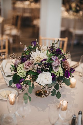 centerpiece-with-wildflowers-ivory-dahlias-amnesia-roses-succulents-eucalyptus-purple-blooms