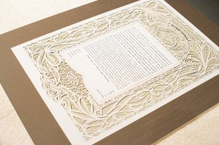 white-ornate-ketubah-on-wooden-board-for-jewish-wedding