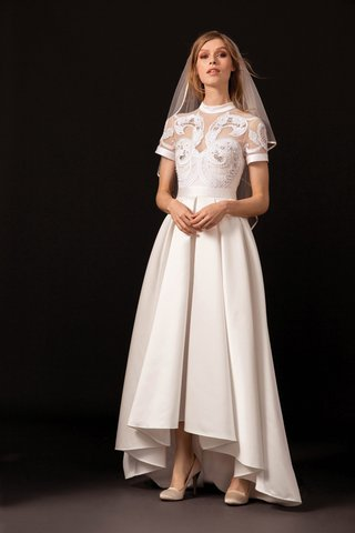 an-illusion-neck-bodice-with-a-high-neckline-capped-sleeves-and-a-slight-high-low-effect-in-the-sk