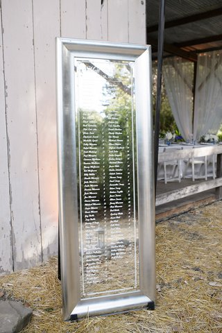 silver-mirrored-table-number-display-at-barn-wedding