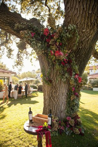 all-you-need-is-love-events-guest-book-table-in-front-of-tree