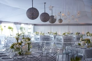 silver-lanterns-at-white-and-green-tent-wedding-reception