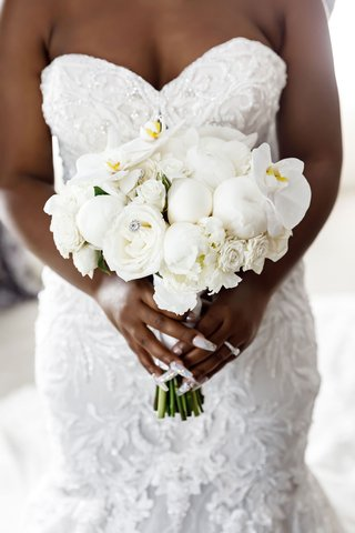 bride-holding-wedding-bouquet-white-rose-peony-orchid-with-jewel-accents-manicure-nails