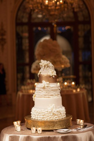 wedding-reception-white-ruffle-and-fondant-wedding-cake-gold-top-layer-and-stand