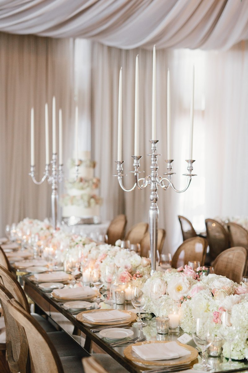 wedding reception low centerpiece white blush with tall silver candlesticks