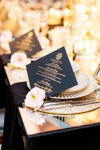 black-menu-cards-with-gold-calligraphy-and-a-single-blush-blossom