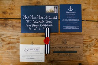 navy-blue-envelope-with-anchor-motif-and-wood-wedding-invitation