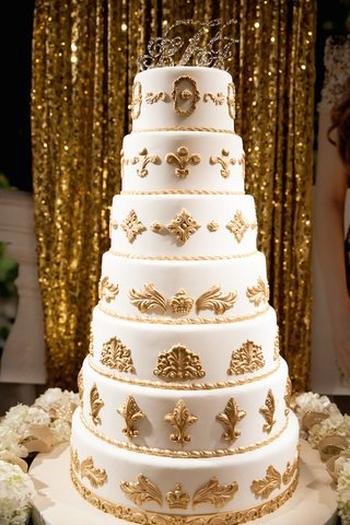 seven-layer-cake-with-gold-molds-and-fleur-de-lis