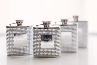 metal-flasks-covered-in-rhinestones-and-engraved-with-bridesmaids-names-and-wedding-date