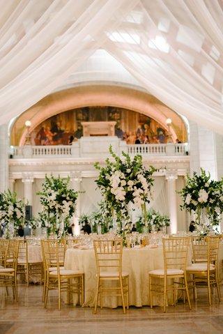wedding-reception-columns-gold-chairs-ivory-linen-greenery-white-flower-centerpiece-heatherlily