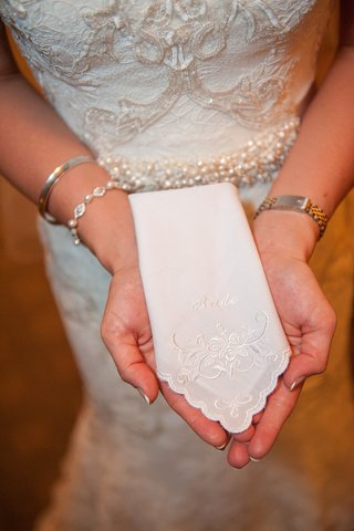 bride-holding-scallop-edge-handkerchief-with-bride-embroidery