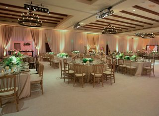 curtains-around-ballroom-with-mismatched-tables-and-chairs