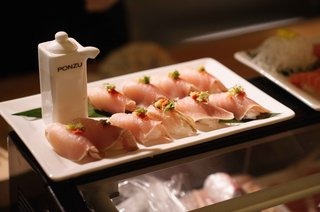 ponzu-soy-sauce-holder-with-sashimi-sushi-on-white-tray-at-carol-leifer-wedding-reception