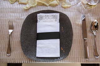 textured-grey-charger-plate-beaded-with-napkin-menu-belly-band-and-champagne-linens-flower-petals