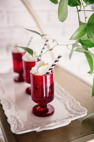 wedding-reception-drinks-black-and-white-straw-whipped-cream-golden-sugar-in-small-red-glasses