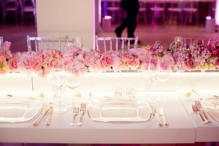 white-table-with-lighted-rectangular-box-topped-with-pink-flowers