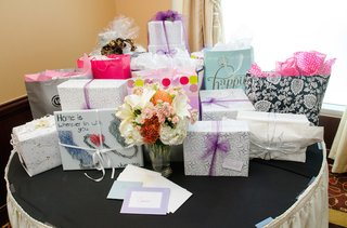 wedding-shower-gift-table-with-black-tablecloth-and-ivory-skirt-bouquet-of-white-stargazer-lilies