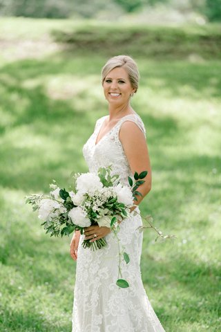 bride-in-beaded-embroidery-wedding-dress-v-neck-updo-white-peony-greenery-leaves-bouquet-garden