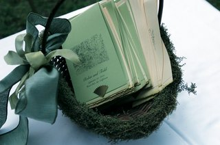 green-and-ivory-wedding-programs-in-wicker-basket