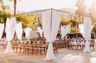 wedding reception courtyard at la quinta resort and spa wood chairs drapery bistro lights stars