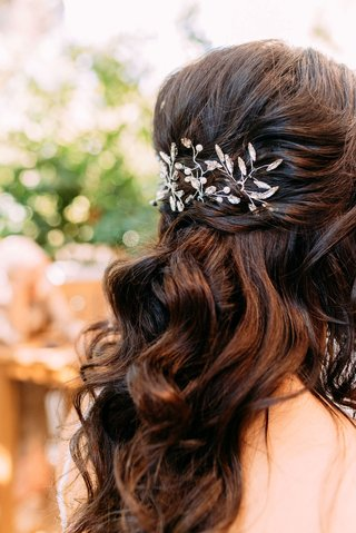 bride-with-long-brown-hair-loose-curls-pulled-back-vine-motif-headpiece-crystal-details