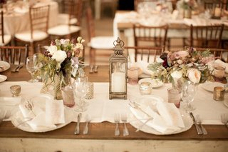 wood-table-topped-with-lace-runner-and-lantern