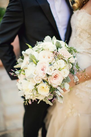 bride-holding-bouquet-of-white-garden-rose-pink-rose-greenery-dusty-miller-accents